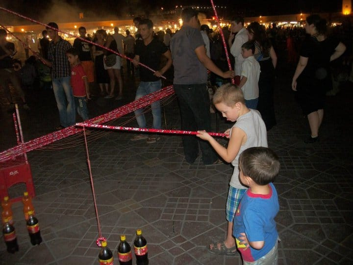Djem al Fna at night with kids