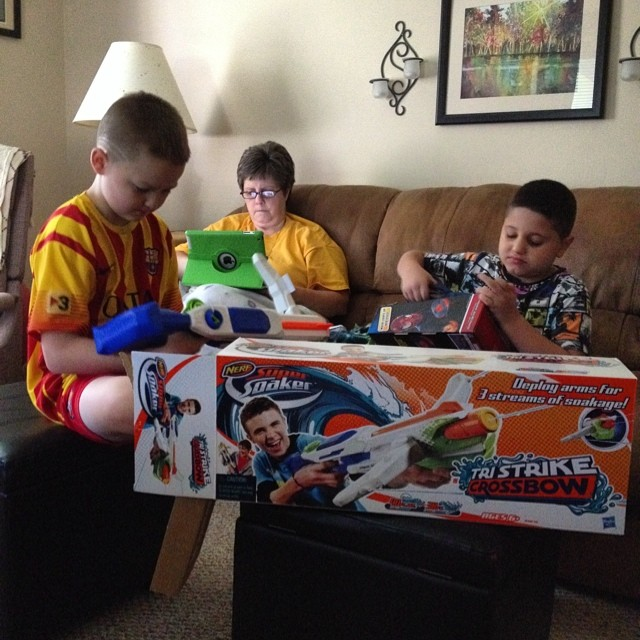 Thanks @hasbro two little guys are ready to play outside in the grass! #water #play #summer #toys #supersoaker