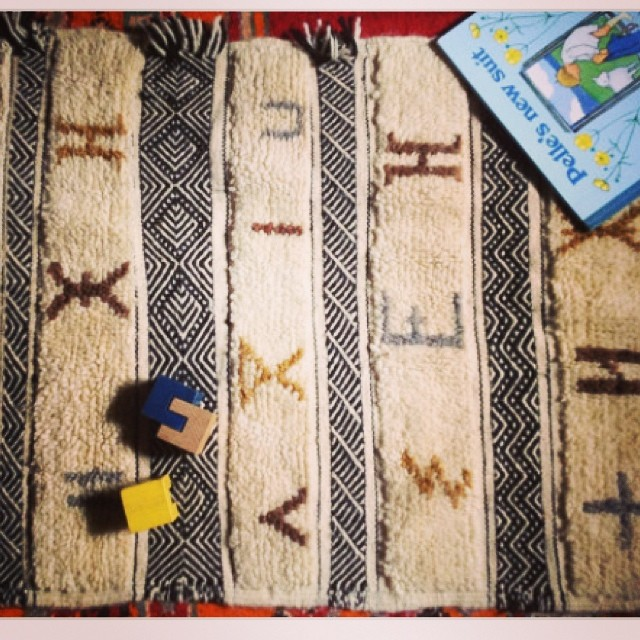 One of my friends has this rug in her etsy shop. Her neighbor in the High Atlas handmade it. I loooove it! Am saving for a full living room rug 3x3 meters that's similar. The symbols are letters of the Tamazight alphabet