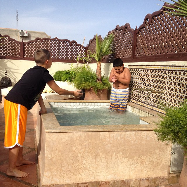 MarocBaba: why do they have to swim at 10am? Me: because they can! Marrakechi #riads most often weren't built with swimming pools but many have plunge pools like this. No complaints from my kids! #travelwithkids #swim #riads @darromman