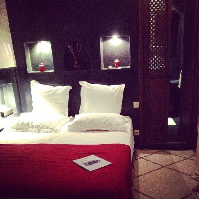 Modern Moroccan in our red and black room. Really love the woodwork in this #riad. It's not something I see so much in Marrakech. #morocco #riads #travel #marrakech
