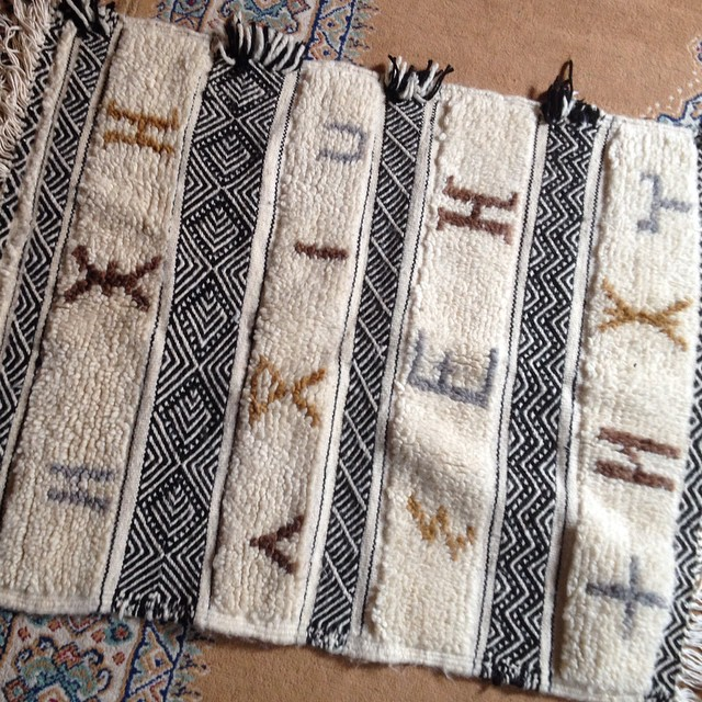 I'm so excited my rug came today!! A friend lives in the High Atlas Mountains and this rug was made by her neighbor. The symbols are letters in the Berber alphabet. I'm in love!