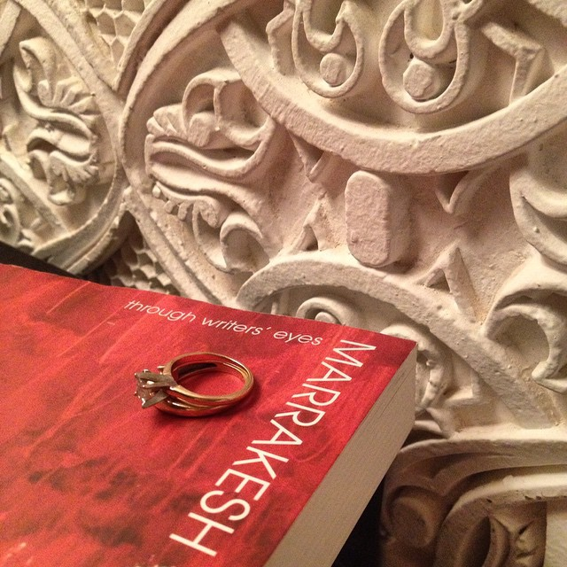 I looked over at my bed stand and saw this just as so. This city is where I met my husband, the color red is everywhere and I've also fallen for the artistry. What more can I ask for? #Marrakech #Morocco #love #books #rings #art