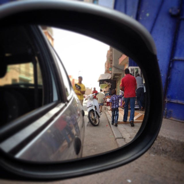 Sometimes it's awkward to take a picture so then I snap through a mirror. I loved this father and son. I saw them walking towards me and the man was completely engrossed in conversation with his little son. Nothing big, just chatting about th