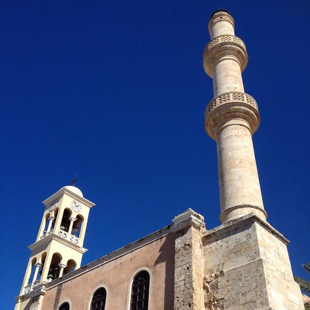 Could it be more beautiful? This was a Venetian church turned to an Ottoman mosque turned to a Greek Orthodox Church. They kept the minaret and church bell. #Crete #greece #HouseTrip #viator #interfaith #religion #mosque #church