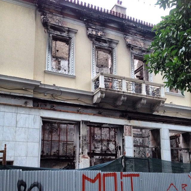 This building on our street in #athens intrigues me. It's completely gutted but this balcony looks untouched. #greece #travel