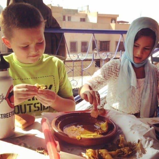 Kids eating Tangia