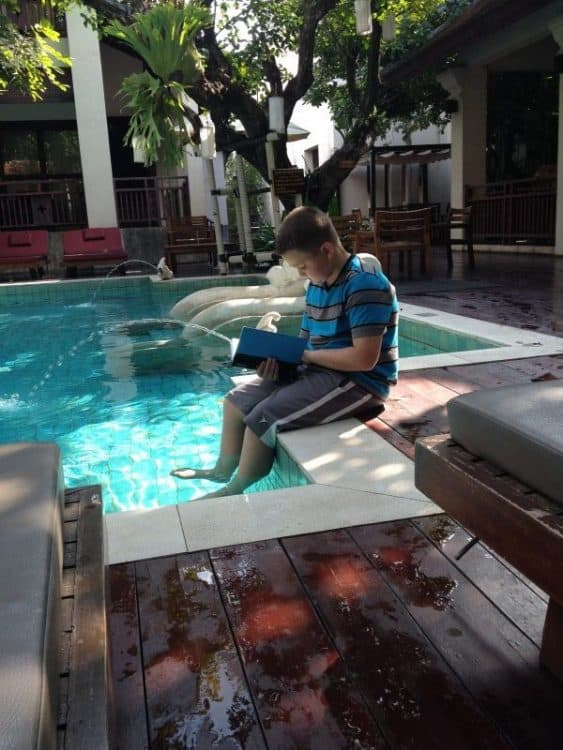 Reading by the Pool in Thailand