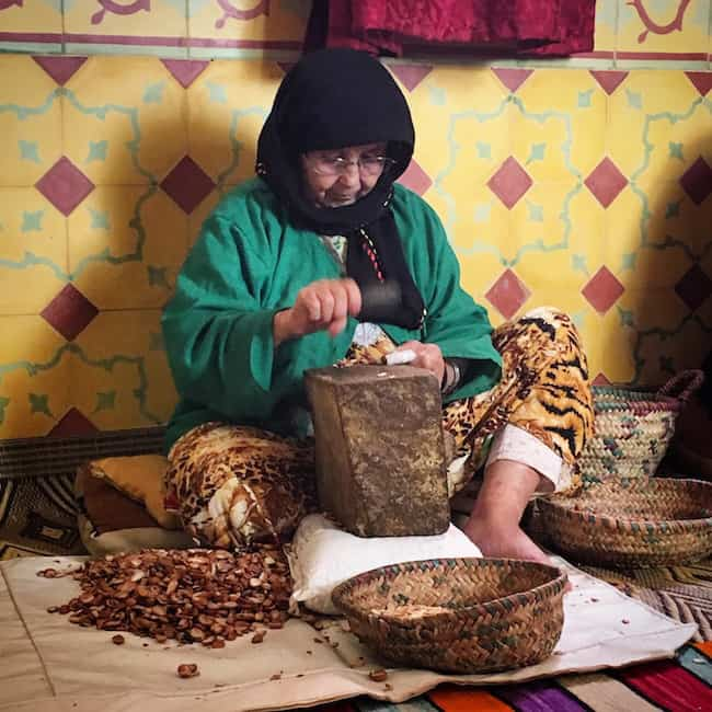 woman breaking argan nuts