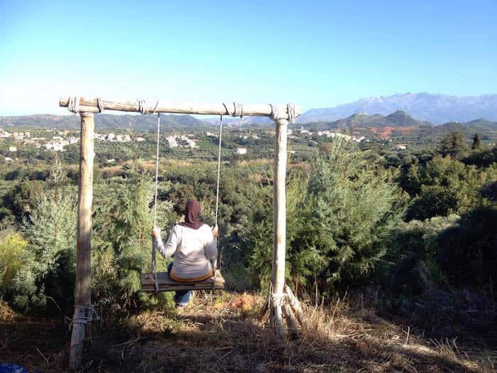 Sitting on a swing in Crete