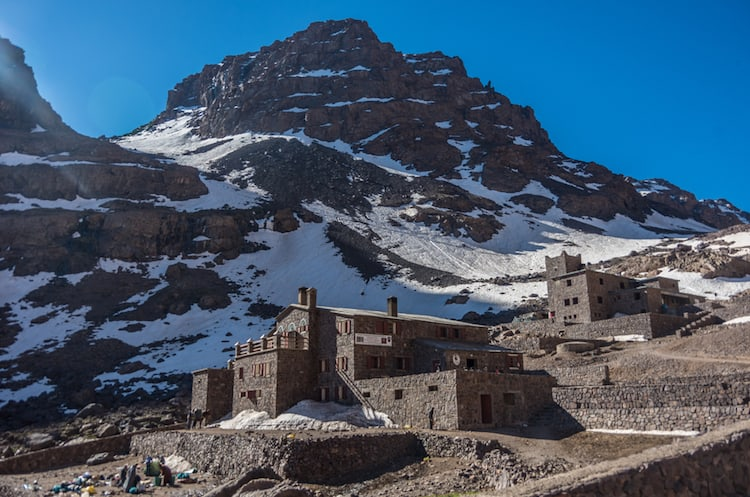 Toubkal national park in springtime with mount, cover by snow and ice, Refuge Toubkal, start point for hike to Jebel Toubkal, – highest peak of Atlas mountains and Morocco