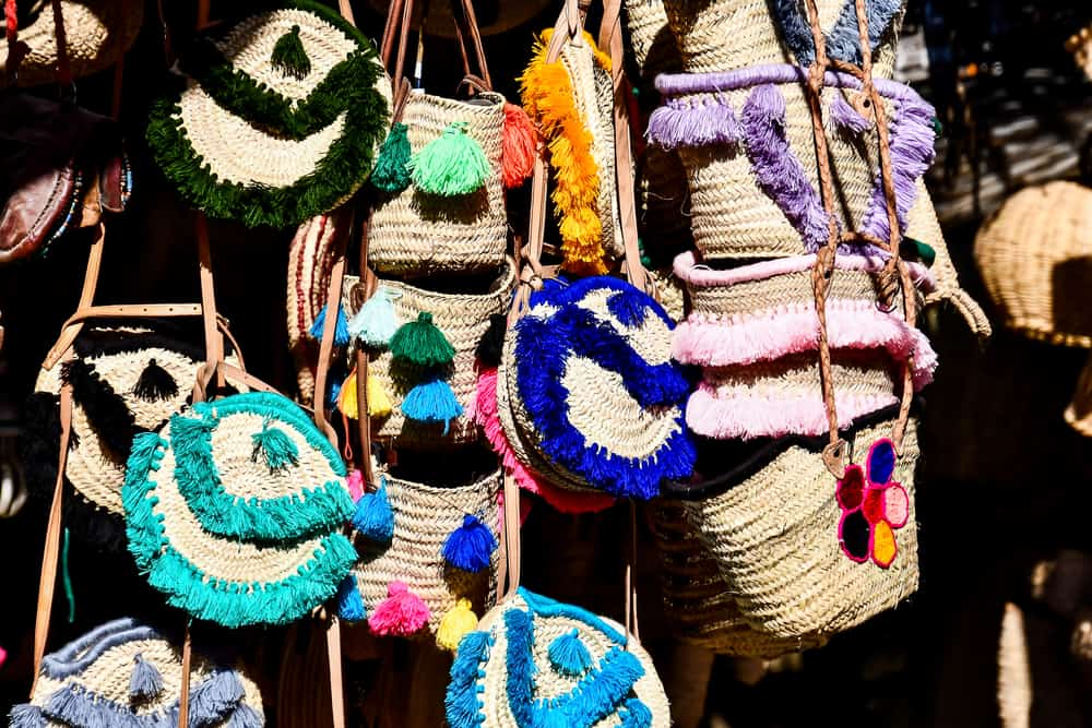 Multi-colored raffia purses hanging in a shop in Morocco
