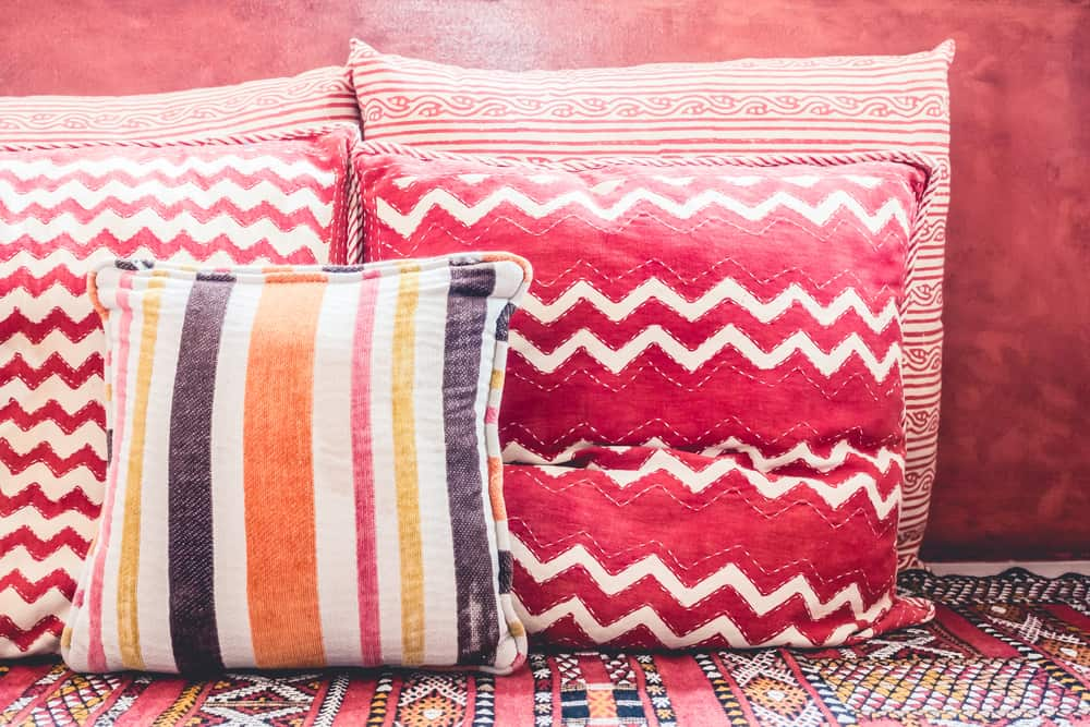 Moroccan throw pillows in pink and red shades