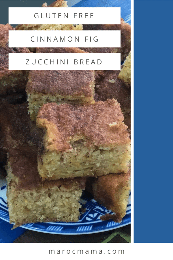 Image of piled pieces of zucchini bread with a brown cinnamon topping on a blue and white plate.