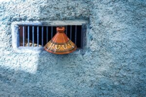 Top of a Tajine sitting by a grated window in Tangier Morocco