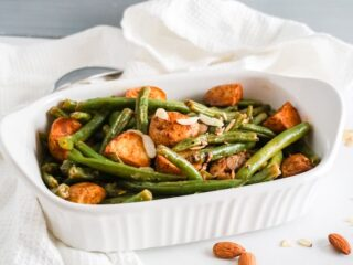 White serving dish with mixed paprika potatoes and green beans